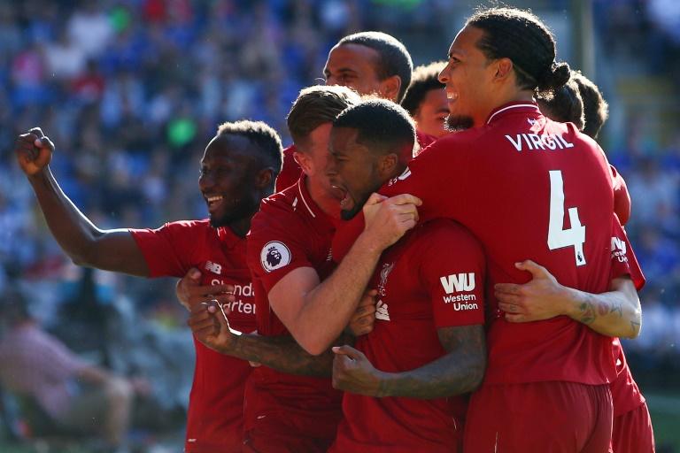 Jogadores do Liverpool comemoram um gol na vitória sobre o Cardiff, 21 de abril 2019