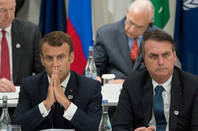 Presidente da França, Emmanuel Macron, ao lado do presidente do Brasil, Jair Bolsonaro, durante reunião do G20. Para Macron, Bolsonaro mentiu.