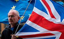 Tempo será curto para obter a eventual ratificação do acordo tanto pelo Parlamento britânico como pela Eurocâmara. (AFP)