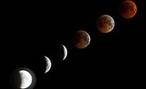 Montagem com a evolução  do eclipse parcial ao total com Lua de Sangue em 2018 ((Vyacheslav Oseledko / AFP))