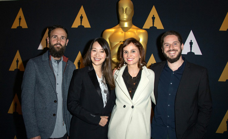O produtor Shane Boris, a diretora e produtora Joanna Natasegara, a diretora Petra Costa e o produtor Tiago Pavan, indicados ao Oscar pelo documentário