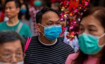 A epidemia de COVID-19 na China contaminou mais de 72.300 pessoas e cerca de 900 em outros países (Dale de La Rey/AFP)