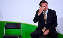 Presidente tem sido acusado de omissão e de desestimular medidas de isolamento e prevenção (Evaristo Sá/AFP)
