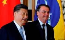 Os presidentes Xi Jinping e Jair Bolsonaro em encontro do Brics em Brasília, em novembro de 2019 (S. Lima/AFP)
