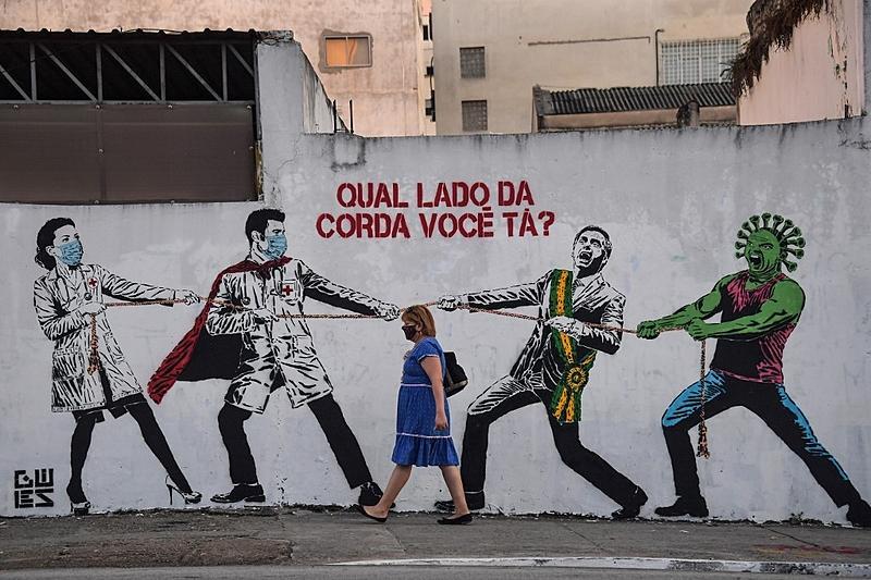 Arte de rua em São Paulo faz alusão à pandemia do novo coronavírus
