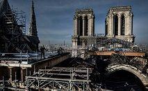 As obras de reconstrução de Notre-Dame poderão começar em 2022, mas o enigma da origem do incidente permanece sem solução (Martin BUREAU/AFP)