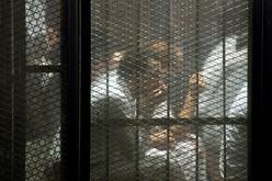 Grupo de detidos durante o julgamento de 700 acusados no Cairo, Egito, em 2018 (Mohamed el-Shahed/AFP)