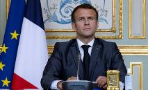 Emmanuel Macron asiste a la cumbre sobre el clima a través de videoconferencia desde el palacio del Elíseo, el 22 de abril de 2021 (Ian Langsdon/AFP)