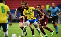 Lance da partida entre Brasil e Venezuela, pela Copa América: seleção visitante teve surto de Covid (Evaristo Sá/AFP)