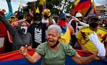 Manifestantes protestam contra a repressão policial em Cali, na Colômbia (Luis Robayo/AFP)