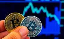 O bitcoin precisa de grandes computadores e energia  para ser gerado (AFP)