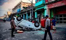 Protestos foram considerados pacíficos pela OEA e governo cubano nega desaparecimentos (Yamil Lage/AFP)