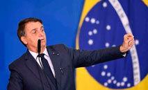 Ao todo, somando as penas máximas para os crimes previstos no Código Penal Brasileiro imputados ao presidente, a punição pode chegar a 38 anos e nove meses de prisão (Evaristo Sá/AFP)