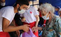 Os jovens da Caritas Internacional trabalhando no Líbano (Reprodução Vatican News)