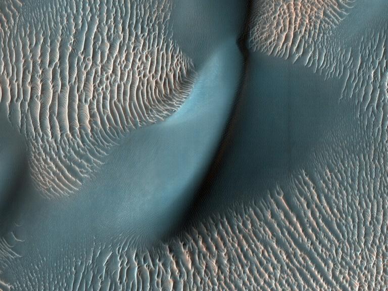 Entre as missões do robô que a China enviará a Marte estarão: realizar análises do solo, da atmosfera, tirar fotos, contribuir para o mapeamento do planeta vermelho e procurar possíveis vestígios de uma vida pretérita (NASA/AFP)