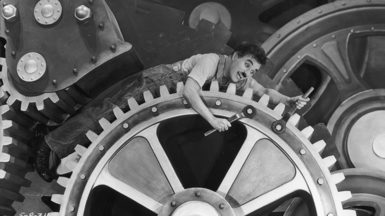 A profecia de Chaplin em Tempos Modernos: as máquinas quebram e podem engolir o ser humano.